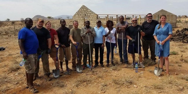 Workers and volunteers building the new home for the Kenyan kids.