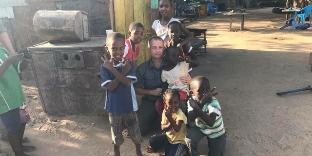 Former Army Reserve Lt. Col. Jason Souza collected 600 pairs of shoes and clothes for the children.