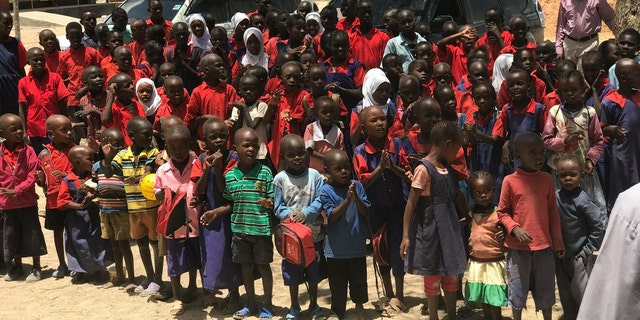 Children at a local secondary school receive 400 pairs of shoes from donors in Virginia, so they no longer have to walk 10 miles a day over thorny, lava rocks to get to school.