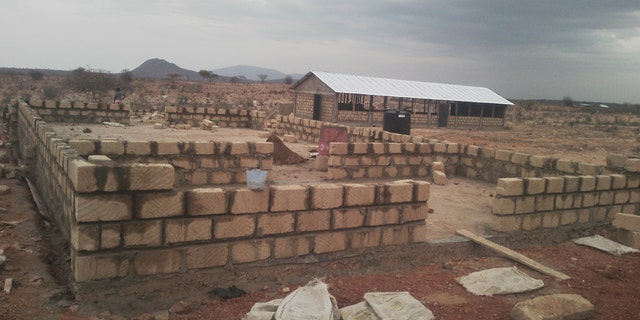 Building the new children's home dorm in Archer's Post, Kenya.