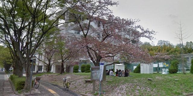 Students sitting outside of Osaka University campus in Japan.