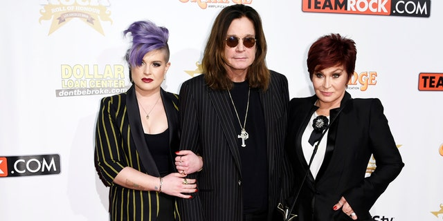 "(L-R) TV personality Kelly Osbourne and her parents, musician Ozzy Osbourne and TV host Sharon Osbourne pose during 10th anniversary of ""Classic Rock Roll of Honour"" awards in Los Angeles, California November 4, 2014. REUTERS/Kevork Djansezian  (UNITED STATES - Tags: ANNIVERSARY ENTERTAINMENT) - RTR4CV9P"