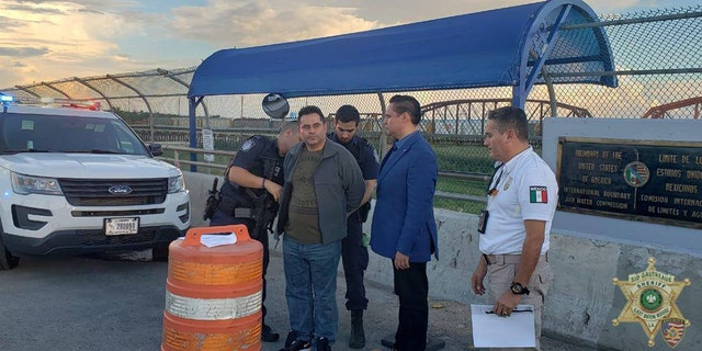 Oscar Lozada brought by Mexican authorities to Border Patrol agents in Eagle Pass, Texas, Thursday.