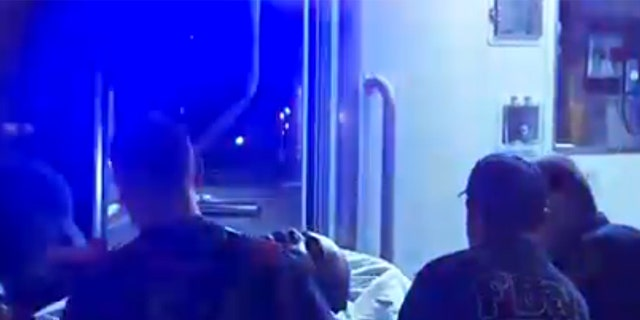 An unidentified patient is loaded into an ambulance on Saturday after police responded to reports of a mass overdose in Brooklyn.