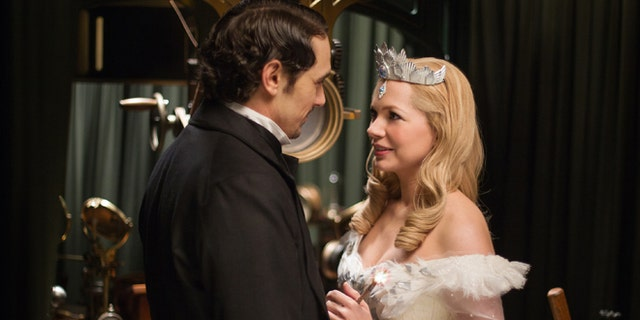 """This film image released by Disney Enterprises shows James Franco, left, and Michelle Williams in a scene from """"Oz the Great and Powerful."""""""