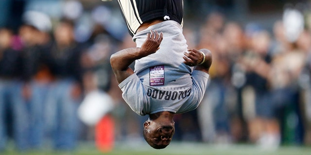 Ozell Williams performs a somersault as part of pre-game ceremonies before a University of Colorado football game.