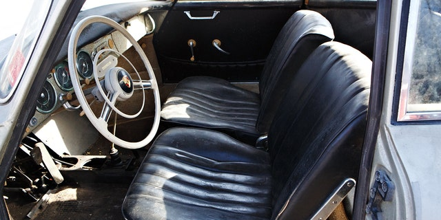 The car has its original leatherette upholstery and 52,837 miles on its odometer.