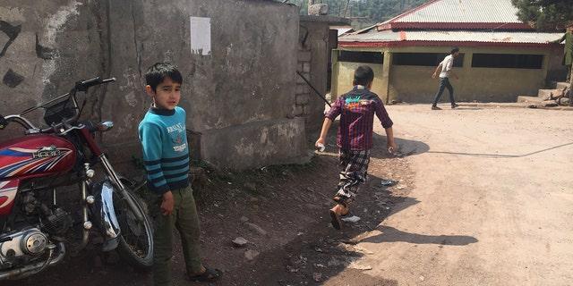Children playing in the Azad Kashmir capital of Muzaffarabad