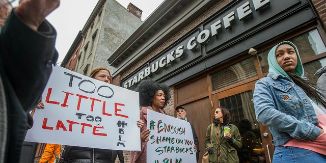 April 15, 2018: Protesters gather outside of a Starbucks in Philadelphia where two black men were arrested Thursday after employees called police to say the men were trespassing.