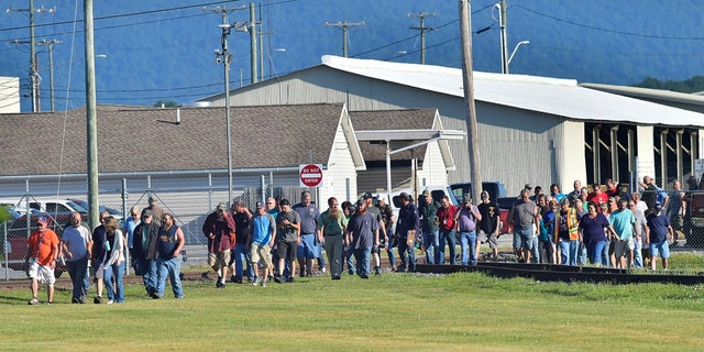 Employees evacuate the area following an incident Thursday, July 19, 2018, at Letterkenny Army Depot in Chambersburg, Pa..