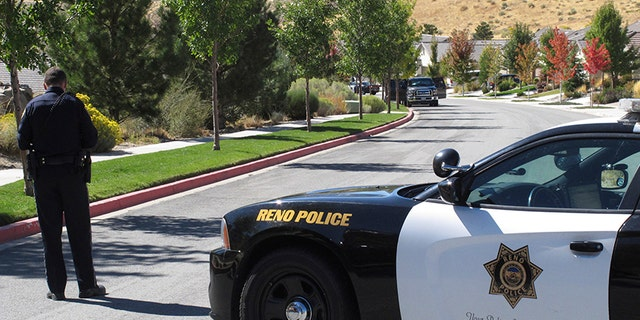 Oct. 2, 2017: Reno police block off the street a half-block away from where authorities searched a home owned by Stephen Paddock.