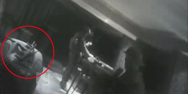 Police body cam footage shows a gun resting on chair. It is unclear if the weapon belonged to Paddock or police.