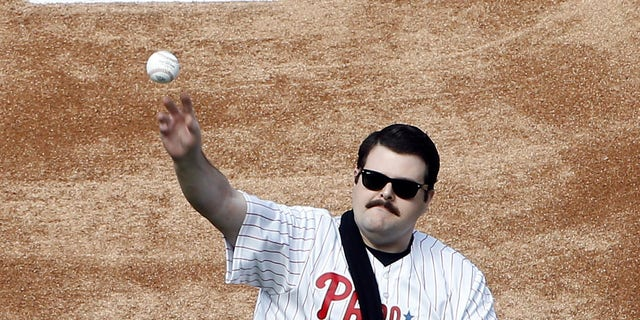 Philadelphia Police Officer Jesse Hartnett throws out a ceremonial first pitch before a Phillies game.