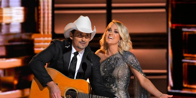 Country music stars Brad Paisley and Carrie Underwood in 2016. Paisley and Underwood will host the Nov. 8 award show.