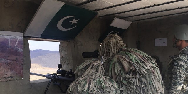 Pakistan soldiers keep watch near the Khyber Pass crossing between Pakistan and Afghanistan