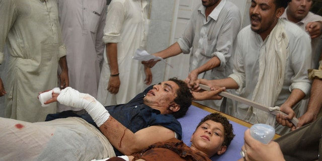 Pakistani blast victims rest at a hospital in Peshawar, Pakistan, Tuesday, July 10, 2018. Police in Pakistan say a suicide bomber has killed a secular party leader and many supporters during an election rally in the northwestern city of Peshawar.