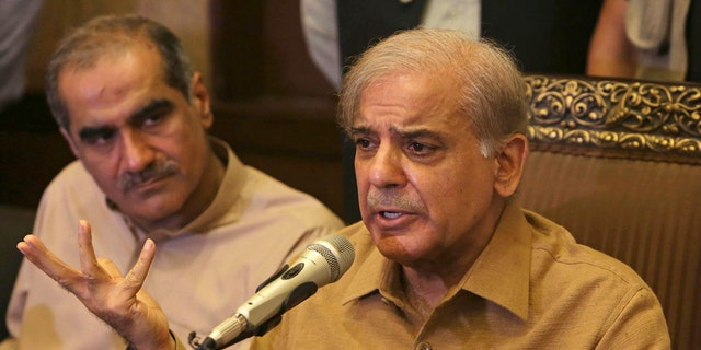 """Shahbaz Sharif, brother of Pakistan's former Prime Minister Nawaz Sharif, who now heads the Pakistan Muslim League, addresses a news conference in Lahore, Pakistan, Thursday, July 12, 2018. Shahbaz Sharif condemned the arrests of their supporters, demanded they stop and that everyone detained be immediately released. He told reporters in Lahore that he plans to be at """"the rally tomorrow to welcome Nawaz Sharif who is returning home with his daughter."""""""