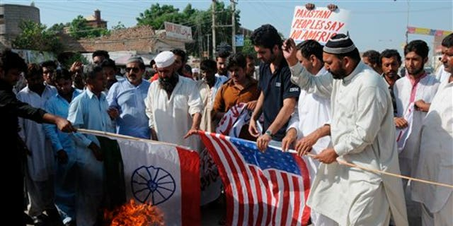 Sept. 23: Pakistani protesters burn representations of US and Indian flags at an anti-American rally in Multan, Pakistan. Pakistan lashed out at the U.S. for accusing the country's most powerful intelligence agency of supporting extremist attacks against American targets in Afghanistan - the most serious allegations against Islamabad since the beginning of the Afghan war.
