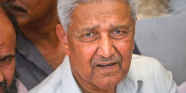 May 8, 2011: Pakistani nuclear scientist Abdul Qadeer Khan is photographed after a silent prayer over the grave of his brother Abdul Rauf Khan, during funeral services in Karachi. (Reuters)