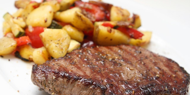 Barbecued beef steak with potaoes and mixed vegetable