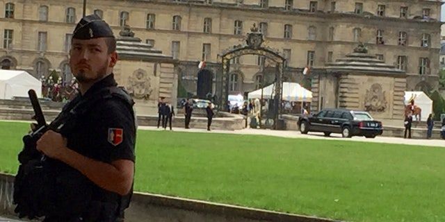 "President Trump's armored vehicle (""The Beast"") enters Les Invalides complex."
