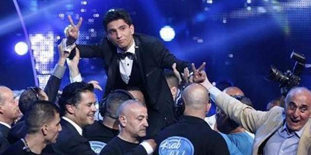 """Muhammed Assaf, a resident of Gaza who won the 2013 """"Arab Idol"""" TV show, has a hit song out celebrating the """"martyrs"""" who kill Jews. (Reuters)"""