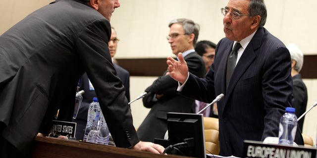 Oct. 10, 2012: Italian Defense Minister Giampaolo Di Paola, left, speaks with United States Secretary of Defense Leon Panetta during a round table meeting of NATO Defense Ministers at NATO headquarters in Brussels.