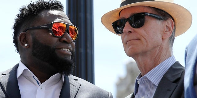 Boston Red Sox owner John Henry, right, said he would consider renaming the street for retired player David Ortiz, left.