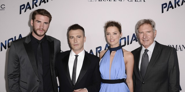 """From left to right, actor Liam Hemsworth, director Robert Luketic, actress Amber Heard, and actor Harrison Ford arrive on the red carpet at the US premiere of the feature film """"Paranoia"""" at the DGA Theatre on Thursday, Aug. 8, 2013 in Los Angeles."""
