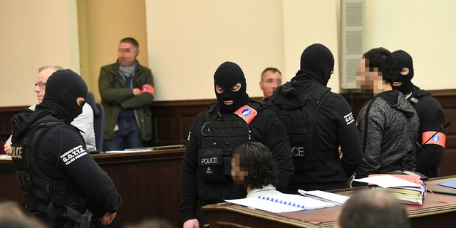 Salah Abdeslam appears in court during his trial in Brussels. He's set to be tried in France, too, for a series of 2015 terror attacks there.