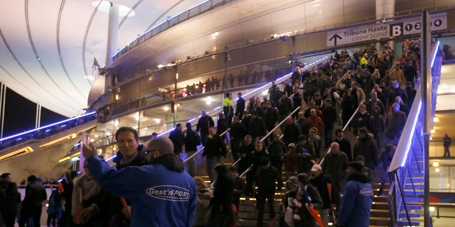 Crowds leave the Stade de France where explosions were reported to have detonated outside the stadium during the France vs German friendly match near Paris, Nov. 13, 2015. (REUTERS/Gonazlo Fuentes)