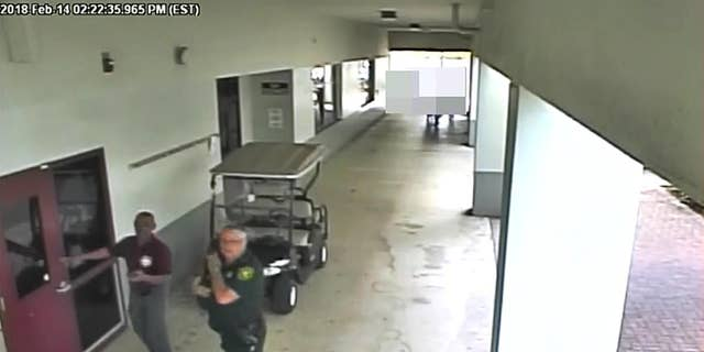 Former Deputy Scot Peterson, right, is seen on newly released video taken during the Feb. 14 Florida school shooting.