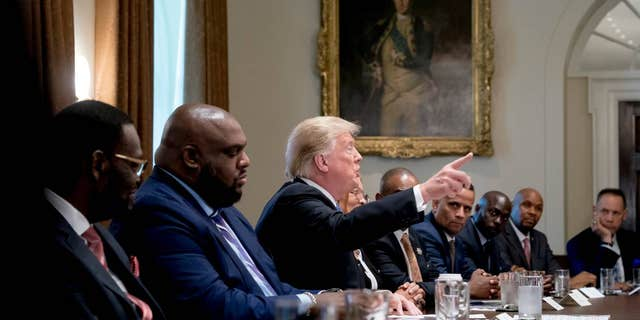 President Donald Trump speaks during a meeting with inner city pastors in the Cabinet Room of the White House in Washington, Wednesday, Aug. 1, 2018.