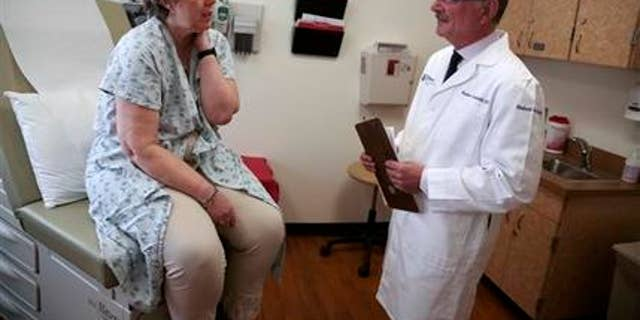 April 28, 2015: Patient Carole Linderman speaks to Dr. Massimo Cristofanilli before her blood is drawn for a liquid biopsy at Jefferson University Hospital in Philadelphia.