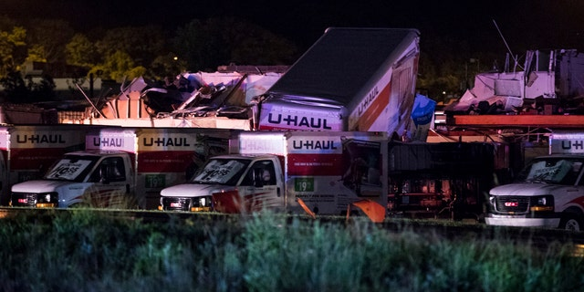 U-Haul trucks parked on Mundy Street in Wilkes-Barre Township, Pa., are damaged after a strong storm moved through the area on Wednesday, June 13, 2018.