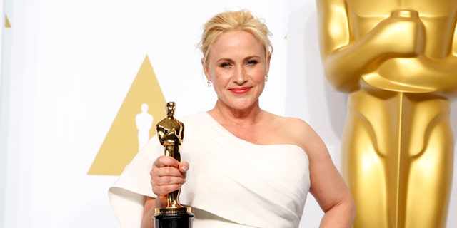 """Feb 22, 2015. Patricia Arquette, best supporting actress winner for her role in """"Boyhood"""" poses with her award during the 87th Academy Awards."""