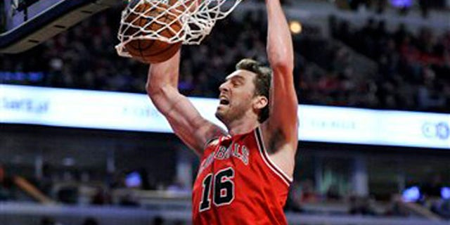 """FILE - This is a Saturday, March 5, 2016 file photo of Chicago Bulls' Pau Gasol (16), of Spain, as he dunks during the second half of an NBA basketball game against the Houston Rockets on in Chicago. Chicago won 108-100.  Pau Gasol says he is considering not playing at the Olympics because of the Zika virus. The Spanish basketball player says there is too much uncertainty about the situation in Brazil and anyone going to Rio de Janeiro for the games should """"think about"""" whether it's worth the risk. (AP Photo/Paul Beaty, File)"""