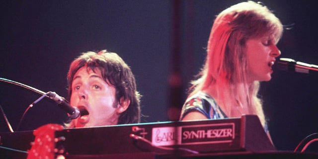 """Bond's producer suggested Paul McCartney's vocal be replaced on 'Live and Let Die,"""" thinking he was just a demo singer. Here McCartney sings with his late wife Linda in their band Wings."""