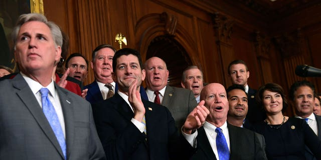 House Republicans, including House Majority Leader Kevin McCarthy of Calif., left, House Speaker Paul Ryan of Wis., fourth from right, and House Ways and Means Committee Chairman Rep. Kevin Brady, R-Texas, fifth from right, wait to start a news conference following a vote on tax reform on Capitol Hill in Washington, Thursday, Nov. 16, 2017. Republicans passed a near $1.5 trillion package overhauling corporate and personal taxes through the House, edging President Donald Trump and the GOP toward their first big legislative triumph in a year in which they and their voters expected much more.