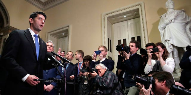 House Speaker Paul Ryan of Wis., left, speaks during a news conference after the House voted to approve the Republican tax bill, Tuesday, Dec. 19, 2017, on Capitol Hill in Washington.