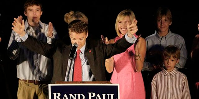Senate candidate Rand Paul raises his arms at his victory party in Bowling Green, Ky., May 18. (AP Photo)