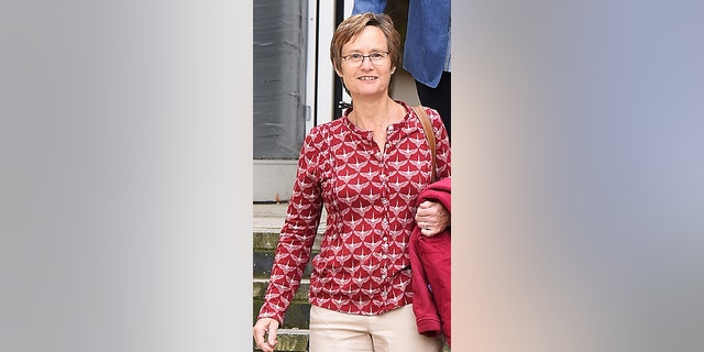 Paula Holland appeared with her partner in court because they allege that their wealthy neighbor harassed them, took photos inside their backyard and blasted loud music.