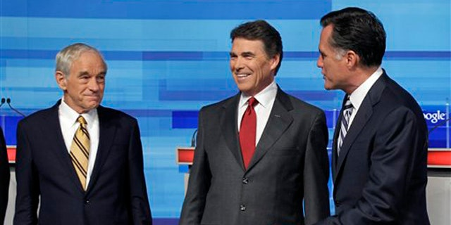 Sept. 22: Republican presidential candidates Rep. Ron Paul, Texas Gov. Rick Perry and former Massachusetts Gov. Mitt Romney greet each other prior to the Fox News/Google debate in Orlando, Fla.