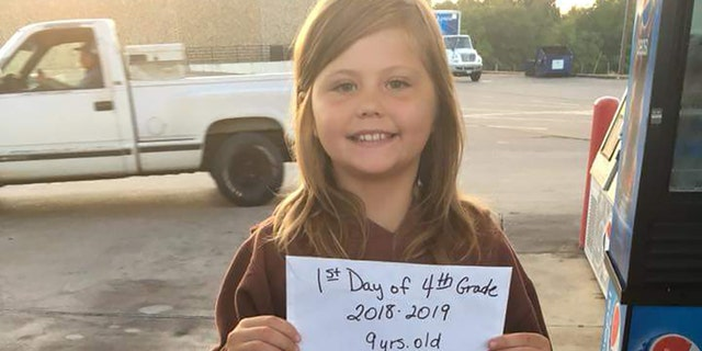 Payton Lynn Crustner, 9, was killed Tuesday in a car collision moments after posing for a first-day-of-school picture, reports said.