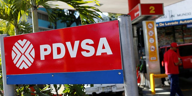 The logo of the Venezuelan state oil company PDVSA is seen at a gas station in Caracas, Venezuela March 2, 2017. Picture taken March 2, 2017. To match Insight VENEZUELA-INDIA/OIL REUTERS/Carlos Garcia Rawlins - RTS11WC0