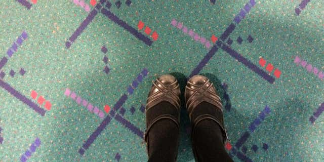 Jan. 23, 2015: This selfie taken by Julie Sabatier, at Portland International Airport in Portland, Ore., shows her feet on older carpet due to be replaced at the terminal.