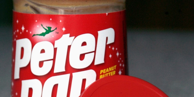 """A recalled jar of peanut butter is shown with the """"2111"""" product code on the lid in Dallas, Texas, February 15, 2007. ConAgra Foods Inc. told consumers to discard jars of Peter Pan and Great Value peanut butter with a product code beginning with """"2111"""" after the spread was linked to a salmonella outbreak which federal health officials say has sickened 288 people in 39 states. REUTERS/Jessica Rinaldi (UNITED STATES)"""