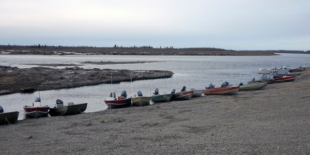 Fishing skiffs line the shore in New Stuyahok, Alaska, as seen in an undated handout picture provided by the Environmental Protection Agency (EPA).