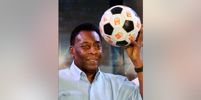 FILE - In this Oct. 12, 2015 file photo, Brazilian football legend Pele poses with a football during an interaction session with students in Kolkata, India. (AP Photo/Bikas Das File)