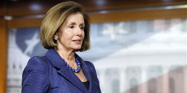 House Minority Leader Nancy Pelosi arrives for a news conference on Capitol Hill April 7.